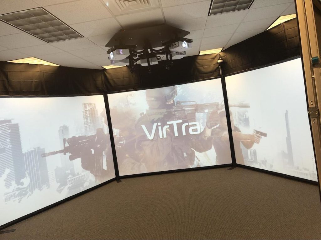 8-ft tall video screen simulation space in 270-degree layout with VirTra logo and projectors