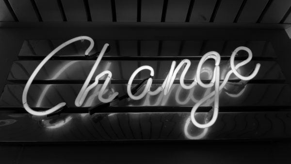 "A neon sign saying, ""Change"" in cursive lettering."