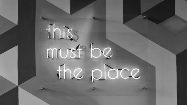 """Photo of neon sign reading """"this must be the place"""" by Tim Mossholder"""